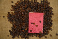 Chinese ang pao and coffee bean over burlap background Stock Photography