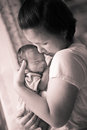Chinese asian malaysian mother and her newborn infant baby boy embracing Stock Photography