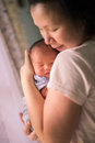 Chinese asian malaysian mother and her newborn infant baby boy embracing Stock Images