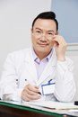 Chinese asian male doctor adult in clinic Stock Photos