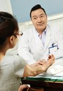 Chinese asian male doctor adult in clinic during pulse diagnosis Royalty Free Stock Images