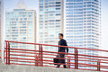 Chinese asian office worker walking commuting work portrait of businessman on bridge in panama to skyscrapers in background Royalty Free Stock Image