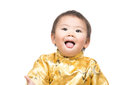 Chinese baby boy with traditional costume showing tongue Royalty Free Stock Images
