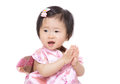 Chinese baby girl clapping hand isolated on white Stock Photography