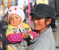 Chinese baby girl and her mother a cute wearing colorful clothes hat with located in chengdu china Royalty Free Stock Photo