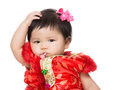 Chinese baby girl scratch her hair isolated on white Stock Photos
