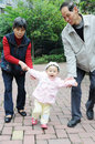 Chinese baby learn to walk Royalty Free Stock Photo