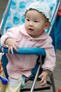 Chinese baby sitting in stroller Stock Photo