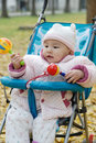 Chinese baby sitting in stroller with toys