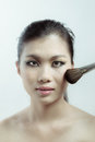 Chinese beauty applying makeup with brush professional in photography studio Royalty Free Stock Photos