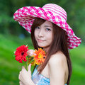 Chinese beauty with colorful african daisy in the forest Stock Image