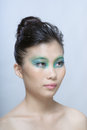 Chinese beauty with professional makeup in photography studio Royalty Free Stock Photography