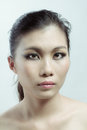 Chinese beauty with professional makeup in photography studio Stock Images