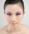Chinese beauty with professional makeup in photography studio Stock Photo