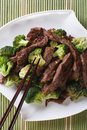 Chinese beef with broccoli closeup. vertical top view Royalty Free Stock Photo