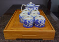 Chinese blue porcelain teapot set on traditional wooden tray Royalty Free Stock Photo