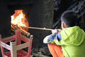 Chinese boy learn to light fire travel agents organize urban children experience life in rural areas the picture shows a studying Stock Image