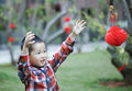 Chinese boy playing red lantern chinese lunar new year Royalty Free Stock Images