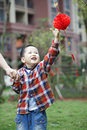 Chinese boy playing red lantern chinese lunar new year Stock Images