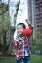 Chinese boy playing red lantern chinese lunar new year Stock Image