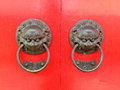 Chinese brass dragon knocker on wooden doors Stock Photo