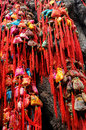 Chinese brocaded sachets on ancient tree colorful were hung the trunk of a as a sort of traditional custom by people praying for Royalty Free Stock Photo