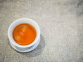 Chinese brown black tea in white cup, on grey fabric cloth table Royalty Free Stock Photo
