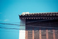 Chinese building style with blue sky and electricity cables Stock Images