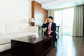 Chinese Businessman on business trip in hotel suite Royalty Free Stock Photo