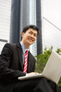 Chinese Businessman Working On Laptop Stock Photos