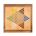 Chinese checker board a vintage wooden checkers with marbles Royalty Free Stock Photos