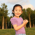 Chinese cheerful girl Stock Photos