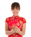 Chinese cheongsam girl holding red packets pretty asian woman with traditional dress or qipao ang pow or packet monetary gift new Stock Photography