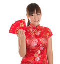 Chinese cheongsam girl showing red packets pretty asian with traditional dress or qipao holding ang pow or packet monetary gift Stock Photos
