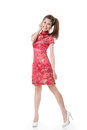Chinese cheongsam girl smiling woman dress traditional at new year studio shot isolated on white background Stock Image