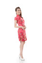 Chinese cheongsam girl smiling woman dress traditional at new year studio shot isolated on white background Stock Images