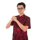 Chinese cheongsam male greeting asian with traditional dress or tang suit new year concept model isolated on white Stock Image