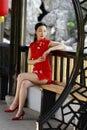 Chinese cheongsam model in Chinese classical garden