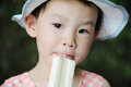 Chinese child eating ice cream Royalty Free Stock Photo