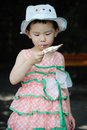 Chinese child eating ice cream Royalty Free Stock Images