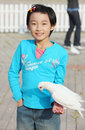 Chinese child with pigeon Stock Image