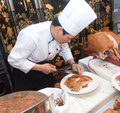Chinese cooks in cutting roast pork Royalty Free Stock Photography