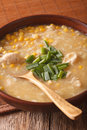 Chinese corn and chicken soup in a bowl close-up. Vertical Royalty Free Stock Photo