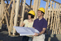 Chinese Couple At Construction Site Royalty Free Stock Photo