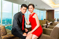 Chinese couple flirting in a luxury sky hotel bar young and handsome luxurious and fancy lounge or Stock Photos