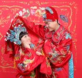 Chinese couple in traditional wedding cloth Royalty Free Stock Images
