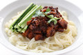 Chinese cuisine noodles topped fermneted soy bean paste fresh cucumber Royalty Free Stock Photos