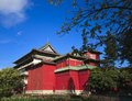 The chinese curture building with red wall and triangle housetop beside pond Stock Image