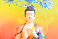 Chinese deity sculpture on vivid background Royalty Free Stock Photo