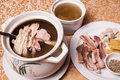 Chinese delicious food pork intestine soup in white casserole Royalty Free Stock Image